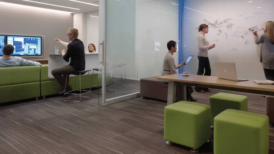 Image of office videoconferencing and collaborative teamwork area