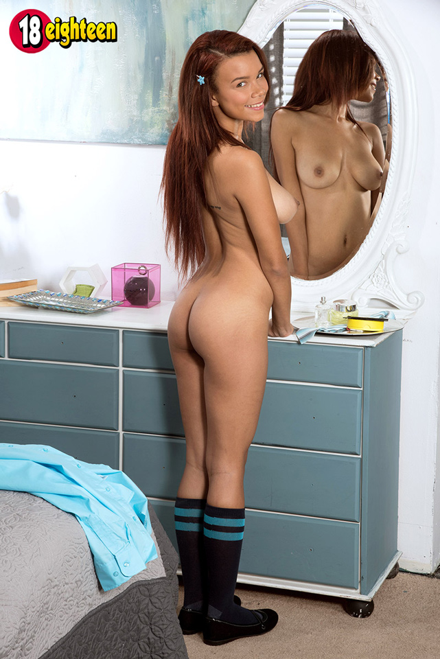 Raven Redmond shows off her bottom and boobs in the mirror