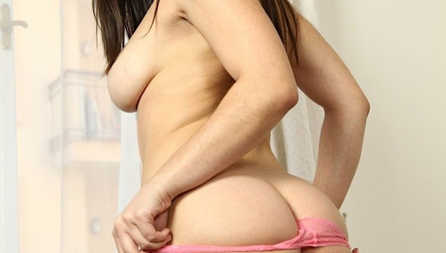 Nekane slowly pushes her pink panties over her big round bottom