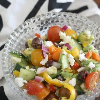 This amazing salad is full of flavor and vitamins. Tomatoes, bell peppers, cucumbers, feta and more. It's so addictive.