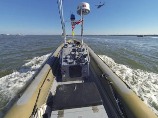 Photo: John F. Williams/U.S. Navy. An unmanned boat operates autonomously during an Office of Naval Research demonstration of swarm boat technology on the James River in Newport News, Va.