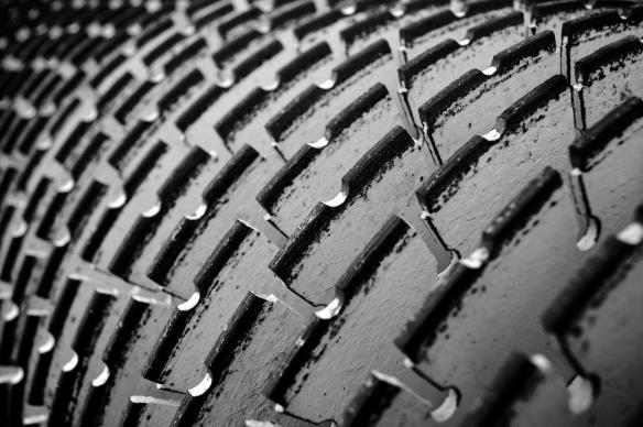 Closeup of a concrete saw used to cut rain grooves in the new roadway surface. Black and White Version #1