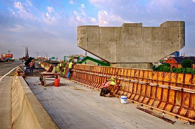 Carpenters form retaining wall on Southbound I-65 near Slugger Field
