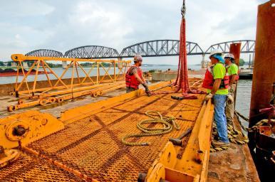 Jesse Jones Jack Klongz and Joe Combs on work barge with tower crane motor deck components. #2