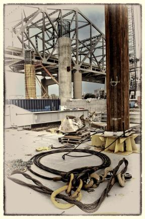 Carpenters Installing Cooling Lines for a Pier on The Ohio River Bridges Downtown Span as seen from the Ringer Crane Barge (Topaz B&W Version)
