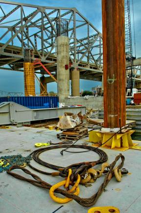 Carpenters Installing Cooling Lines for a Pier on The Ohio River Bridges Downtown Span as seen from the Ringer Crane Barge