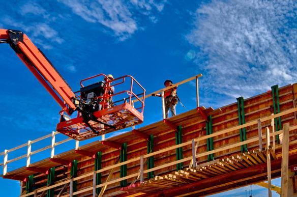 Carpenters Installing Safety Rail