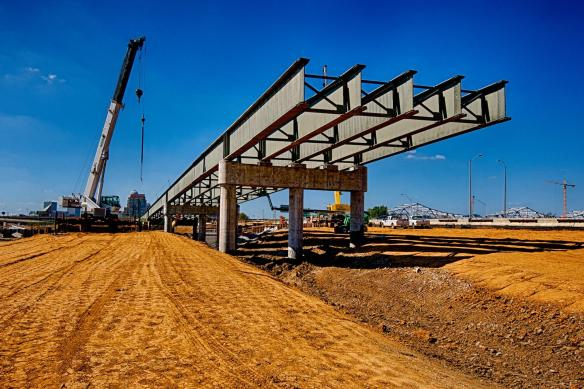 Steel Girders for the I-71 section of Spaghetti Junction march east.