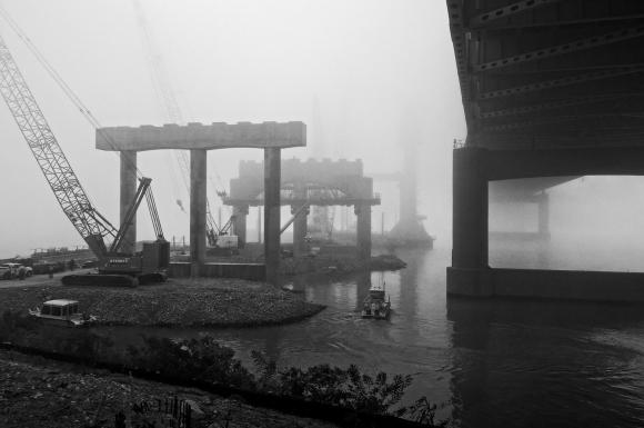 A foggy morning as the crew boat navigates alongside Pier Seven of the Downtown Span on the Ohio River Bridges Project in Louisville, Kentucky. (Processed with NIK Silver Efex Pro 2)