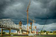 Storm clouds gather over the Indiana shore of the Ohio River and the Downtown Crossing construction for the Ohio River Bridges Project. #5