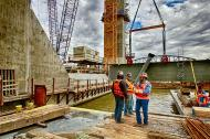 An unidentified Ironworker talks with Mike Haycraft and Brad Mires about the pick of the Edge Girder for Tower Five on the Ohio River Bridges Project.