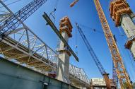 Two Cranes fly the first Edge Girder for the Downtown Span into place on Tower Five.