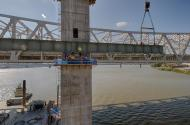 The Structural Gang works to attach the first Edge Girder to the wester leg of Tower Five of the Ohio River Bridges Project in Louisville, Kentucky.