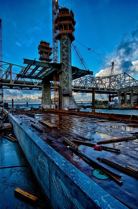 Early morning on Pier 5 after a short period of rain. The barge in the foreground is there to use as an assembly point for steel rebar and concrete form as the tower is extended up.