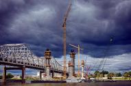 Storm clouds gather in a Purple Sky over the Indiana shore of the Ohio River and the Downtown Crossing construction for the Ohio River Bridges Project.