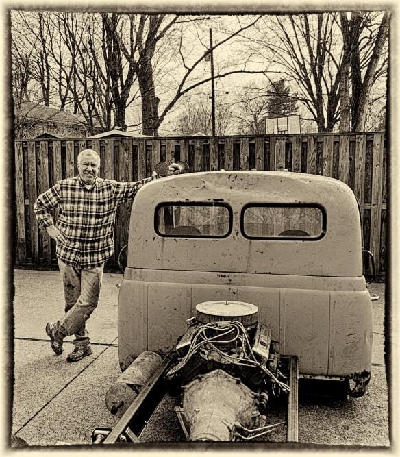 Sam Humston standing beside his latest project a mid-engine 1952 International Harvester COE truck.