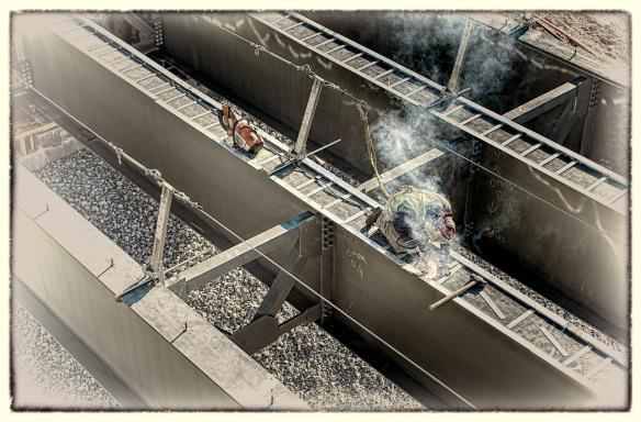 Ironworker welding on a bridge girder. #2