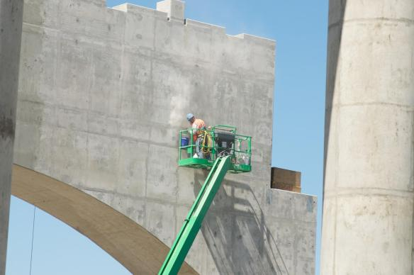 Concrete finisher at work on surface of bridge anchor. #1