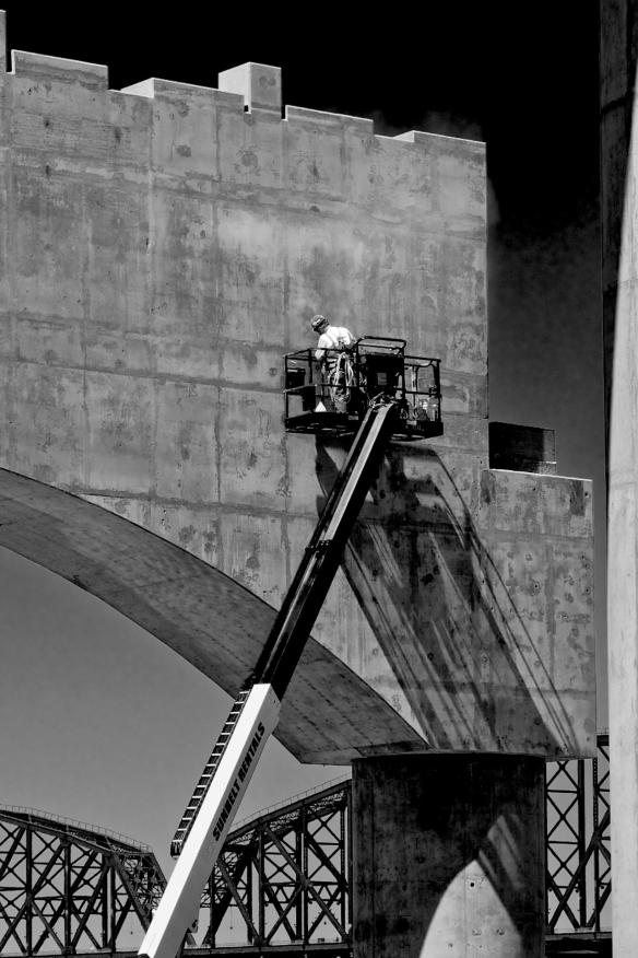 Concrete finisher at work on surface of bridge anchor. #2 B&W Version
