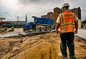 Juan Perez, Trades Superintendent for Walsh Construction monitors delivery of crushed stone to MSE wall site.