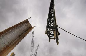 Flying the pile driver and a H-Beam into place at Preston and Jefferson Streets in Louisville, KY.