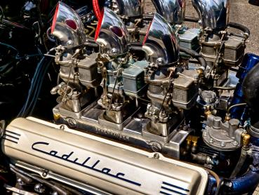 Cadillac Engine with Six Two Barrel Carbs.