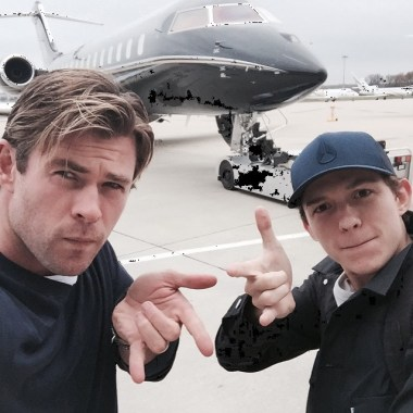 Tom Holland and Chris Hemsworth strike a Spider-Man pose!