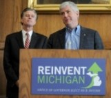 Governor-elect Rick Snyder, center, announces the appointment of House Speaker Andy Dillon, left, as treasurer and former Lt. Governor Dick Posthumus as senior adviser to the Governor at University of Michigan's Gerald R. Ford School of Public Policy in Ann Arbor on Nov. 8, 2010.  Angela J. Cesere | AnnArbor.com
