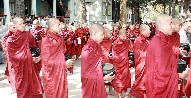 Procession of Buddhist monk on their way to eat/Flickr photo by dany13