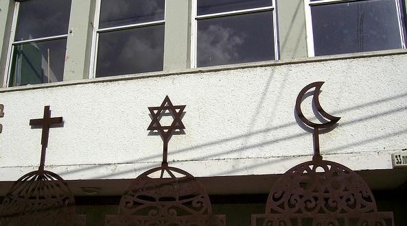 Jewish Star of David, Arab- Christian Cross and Crescent on the front of Beit Hagefen, Arab-Jewish Center in Haifa since 1963./Flickr photo by zeevveez
