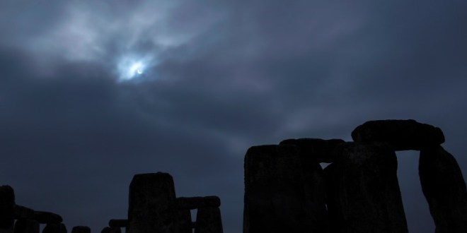 A partial solar eclipse is seen over Stonehenge in south west England, March 20, 2015. REUTERS/Kieran Doherty
