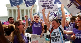 Demonstrators celebrate at the Supreme Court after the court struck down a Texas law imposing strict regulations on abortion doctors and facilities. REUTERS/Kevin Lamarque