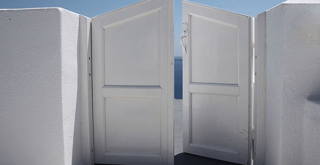 Wikipedia photo of half-open doors by Klearchos Kapoutsis from Santorini, Greece