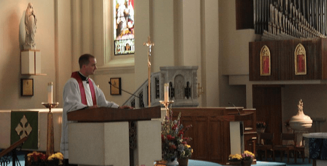 Rev. Curtis Seidel leads a service at Our Lady of Lourdes Cathedral to remember Orlando shooting victims/Peter Houston-Hencken - SpokaneFAVS