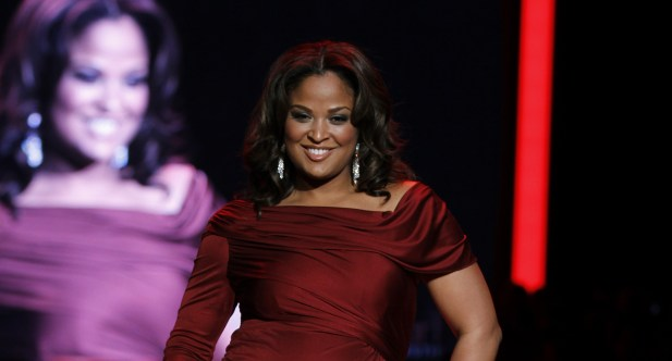 Laila Ali modeling in 2011 Heart Truth fashion show
