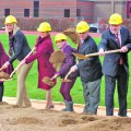 U of M Interim AD Beth Goetz (second from left) and President Eric Kaler (second from right) were among the first selected group of donors who participated in the Minnesota's Athletes Village ceremonial dig on October 30.