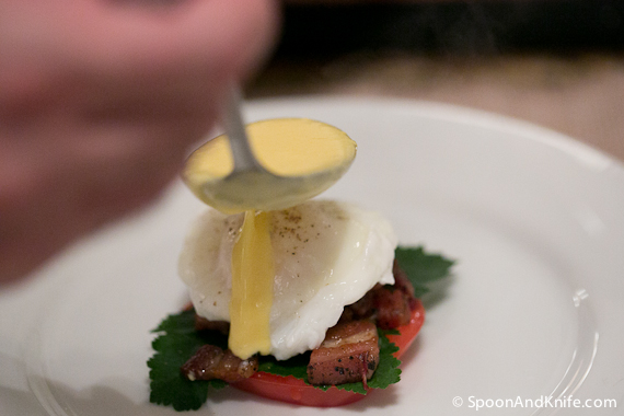 Pouring the Hollandaise sauce over the top