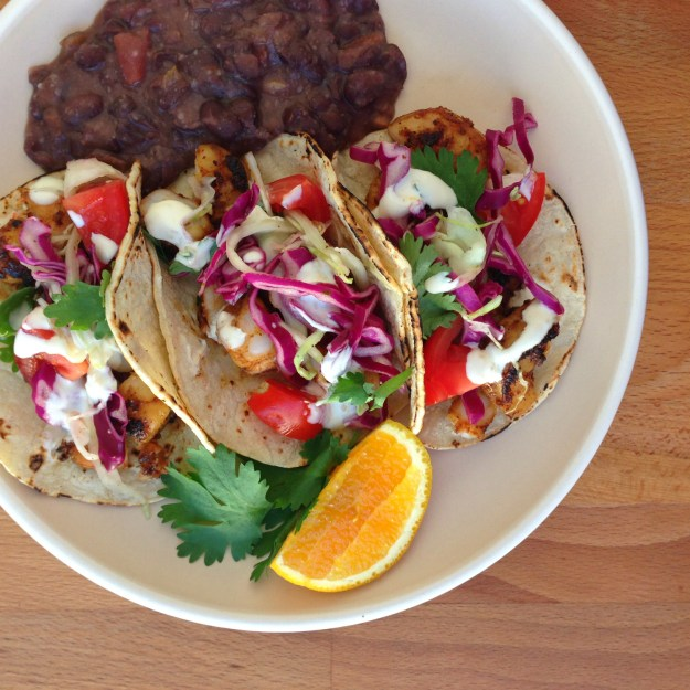 chipotle shrimp tacos / salsa beans / slaw with cilantro vinaigrette
