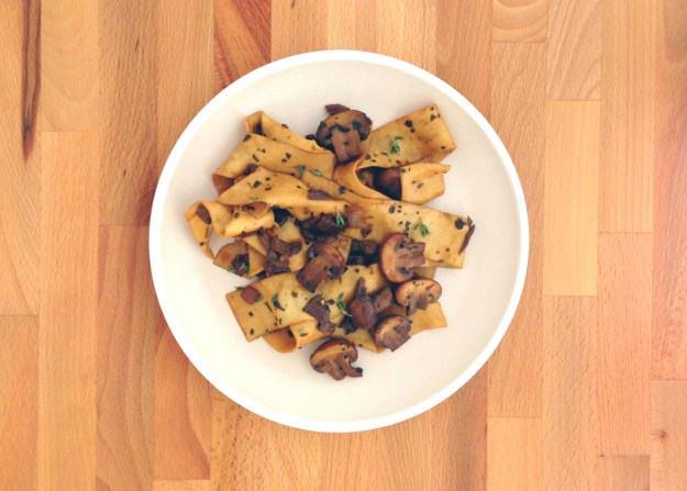 pappardelle pasta with mushroom ragout / balsamic dressed greens