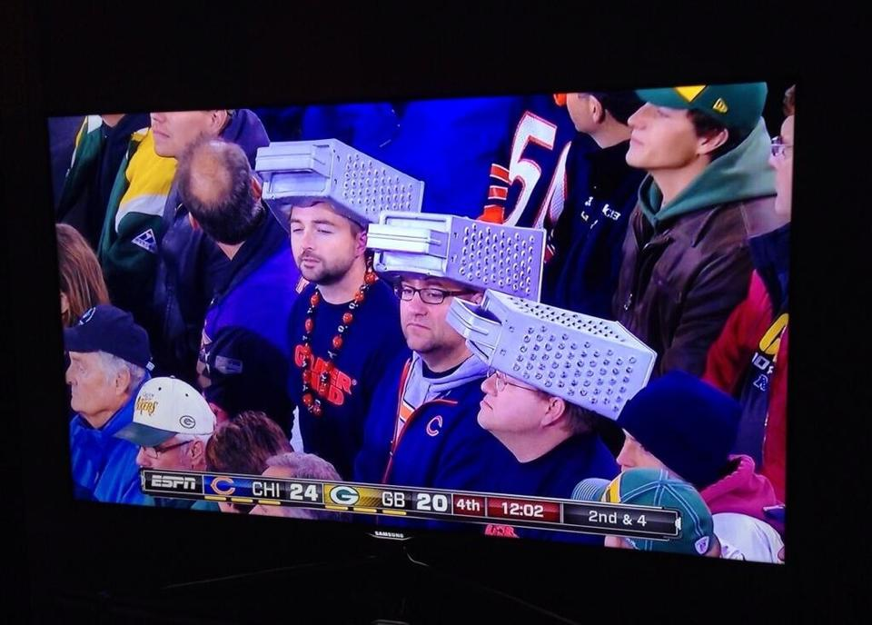 Bears fans wear cheese graters on their heads (photo ...