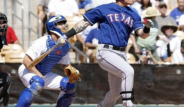 Texas Rangers Hamilton hits a tow run homerun during the first inning of a spring training baseball game against the Los Angeles Dodgers in Glendale, Arizona