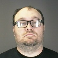 Father charged with raping stepson's girlfriend