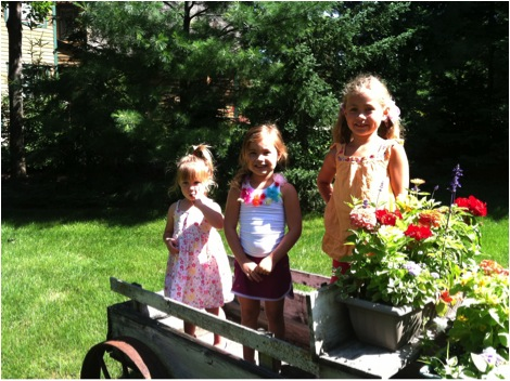 my girls love to help mom plant flowers and pick veggies