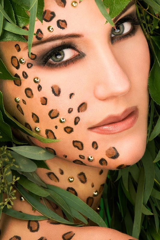 Beauty retouch of a model with cheetah makeup down face and back