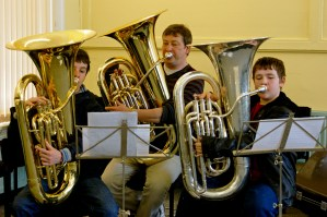 Tutors will often play with the bands to help them out during rehearsals