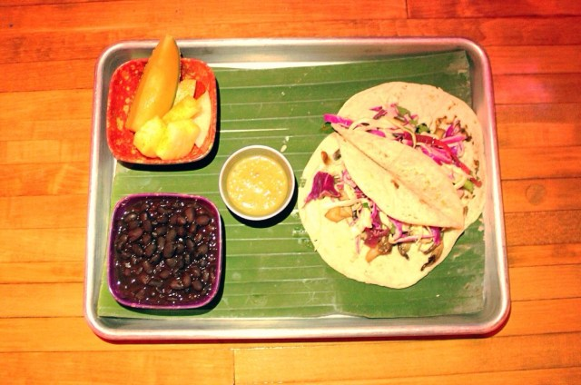 Nothing Fishy About These Tacos #vegan fish tacos! Served with black beans, season fruit and salsa verde (here we go again with the great salsa!)