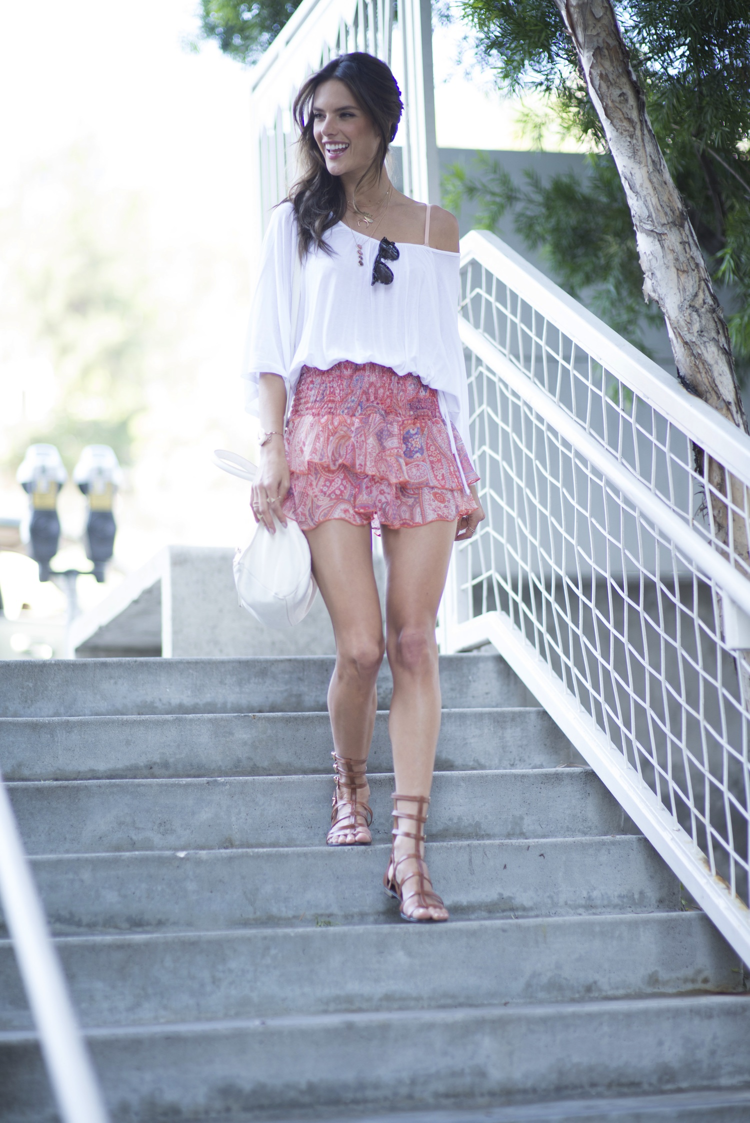Alessandra Ambrosio stepped out in Santa Monica yesterday wearing a double layer skirt and starlight tee from ále by Alessandra. Get this look and more from her new collection at shopplanetblue.com