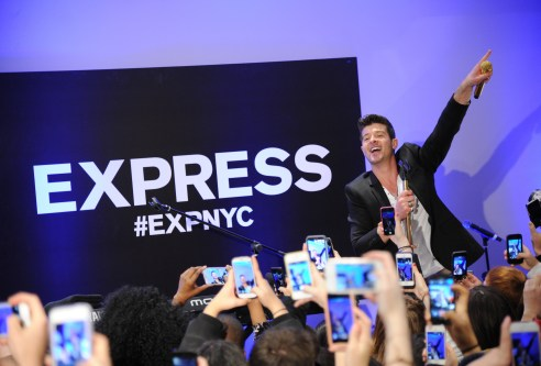 Robin Thicke kicked off the EXPRESS Times Square Grand Opening event with a live performance for crowds of customers on March 25, wearing the EXPRESS Photographer Suit and Henley Graphic Tee. The performance was broadcasted via live stream on the retailer's 9,000 square foot billboards outside the store.  Following the performance, the Blurred Lines star even stopped to take selfies with a few lucky fans!