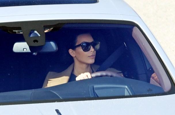 Kim Kardashian leaves Bruce Jenner's Malibu home.