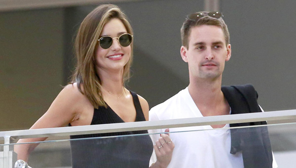 "Miranda Kerr and her billionaire boyfriend & ""Snapchat"" founder, Evan Spiegel can't keep their hands off each other as they prepare to take a trip out of the United States.  The adorable couple were seen hugging, whispering & laughing as they prepared to fly out of LAX.  Pictured: Miranda Kerr, Even Spiegel Ref: SPL1101464  120815   Picture by: Sharky / Splash News  Splash News and Pictures Los Angeles:	310-821-2666 New York:	212-619-2666 London:	870-934-2666 photodesk@splashnews.com"